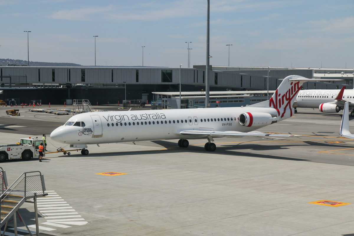 VH-FSQ Fokker 100 (MSN 11450), named 'Bill's Bay', of Virgin Australia Regional Airlines, at Terminal 1 Domestic on the first day of operations, Perth Airport - Sun 22 November 2015. The first Fokker 100 to depart from the new terminal - flight VA1483 to Broome, pushing back from Bay 144 at 10:42am. Sister ship VH-FZH was supposed to be the first F100 to depart as VA1877 to Newman, but was delayed at the last moment and departed several minutes late. Photo © David Eyre