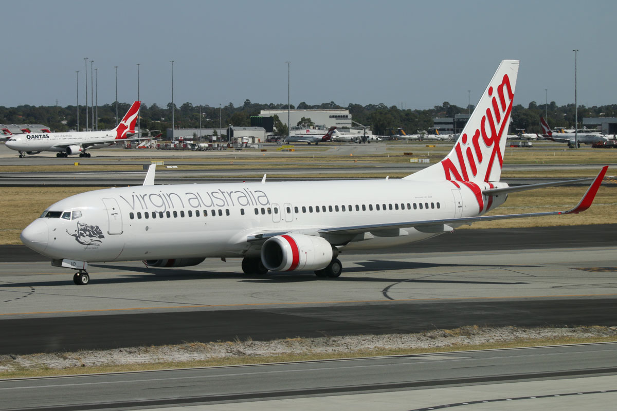 VH-VUD Boeing 737-8FE (MSN 34015/1594) of Virgin Australia, named 'Tallows Beach', at Terminal 1 Domestic on the first day of operations, Perth Airport - Sun 22 November 2015. The first Boeing 737 to arrive at the new terminal, flight VA551 from Sydney, taxying in at 9:17am. It parked at Bay 48B. Photo © David Eyre