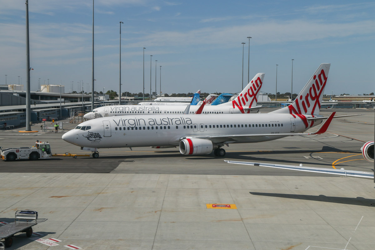 VH-VUV Boeing 737-8FE (MSN 34015/1594) of Virgin Australia, named 'Binalong Bay', at Terminal 1 Domestic on the first day of operations, Perth Airport - Sun 22 November 2015. The first Boeing 737 to depart from the new terminal, operating flight VA682 to Melbourne, pushing back from Bay 143 at 9:10am. Photo © David Eyre