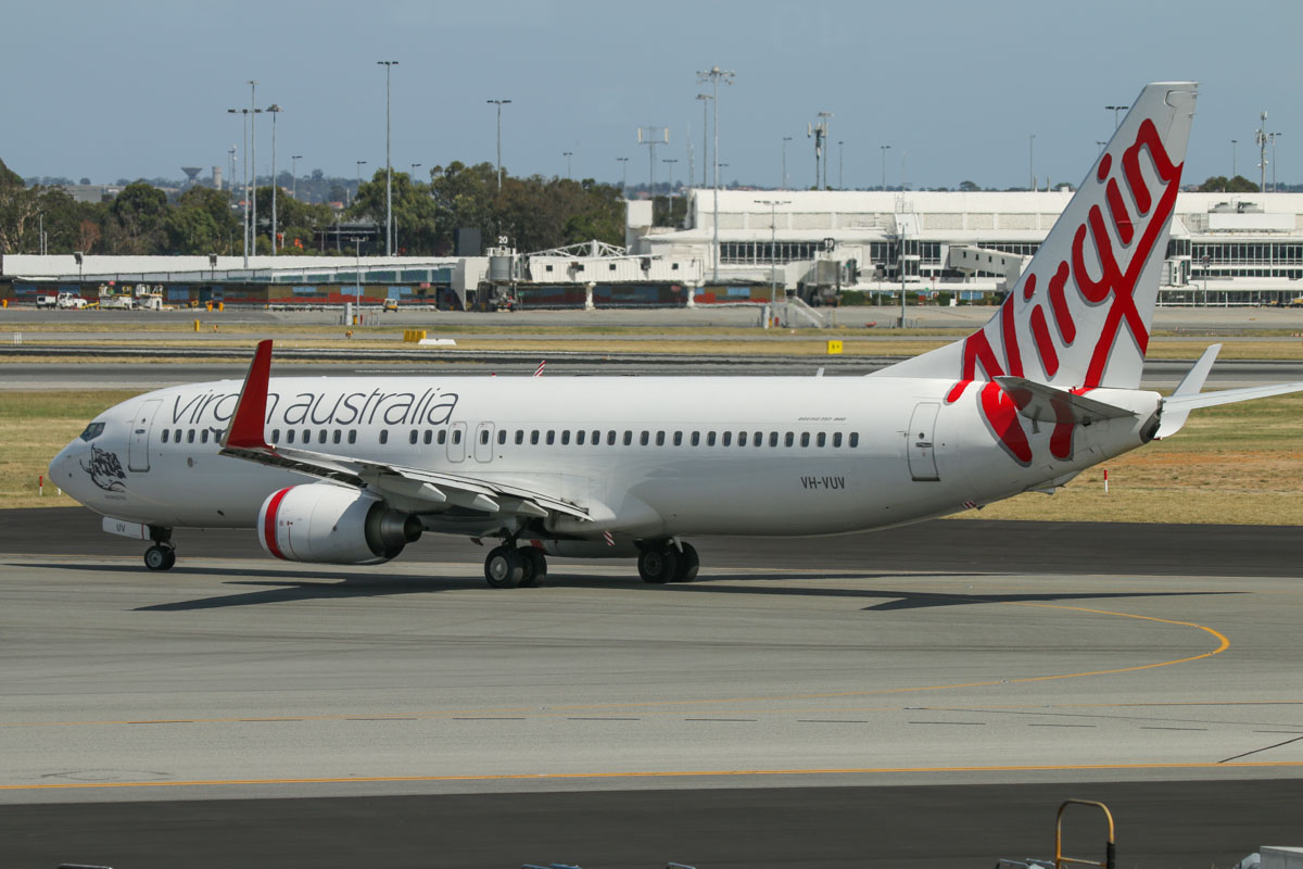 VH-VUV Boeing 737-8FE (MSN 34015/1594) of Virgin Australia, named 'Binalong Bay', at Terminal 1 Domestic on the first day of operations, Perth Airport - Sun 22 November 2015. The first Boeing 737 to depart from the new terminal, operating flight VA682 to Melbourne, taxying out to runway 06 at 9:16am. Photo © David Eyre