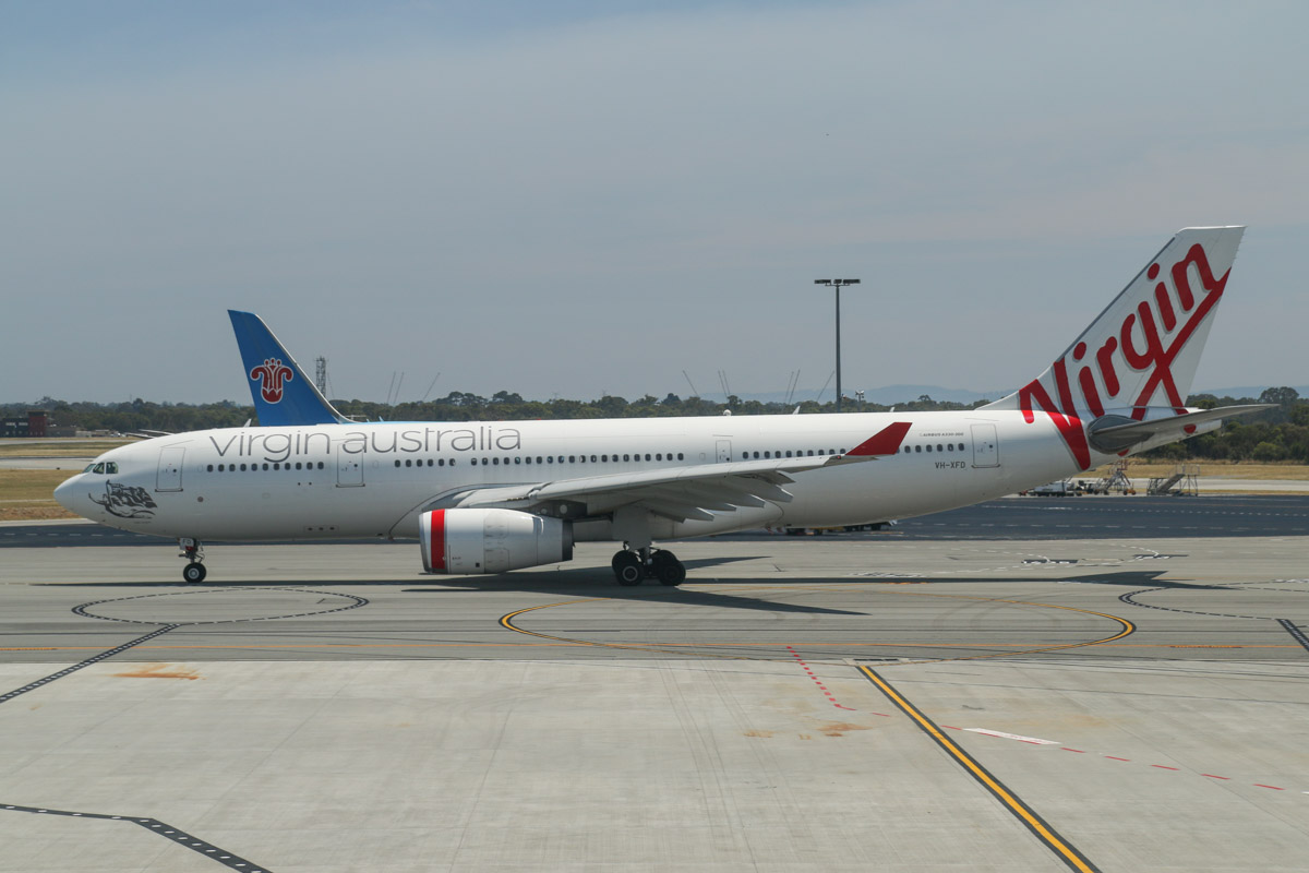 VH-XFD Airbus A330-243 (MSN 1306) of Virgin Australia, named 'Bells Beach', at Terminal 1 Domestic on the first day of operations, Perth Airport - Sun 22 November 2015. The first Airbus A330 to depart from the new terminal, operating flight VA556 to Sydney, taxying out to runway 06 at 10:57am, after pushing back from Bay 150. Photo © David Eyre