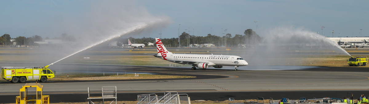 VH-ZPN Embraer 190AR (ERJ-190-100IGW) (MSN 19000312) named 'Arrawarra Beach,' of Virgin Australia, at Perth Airport - Sun 22 November 2015. The first flight to use the new Terminal 1 Domestic, flight VA713 from Adelaide, is welcomed with a water cannon salute from Airport Rescue and Fire Fighting as it taxies in at 7:24am after landing on runway 03. Photo © David Eyre