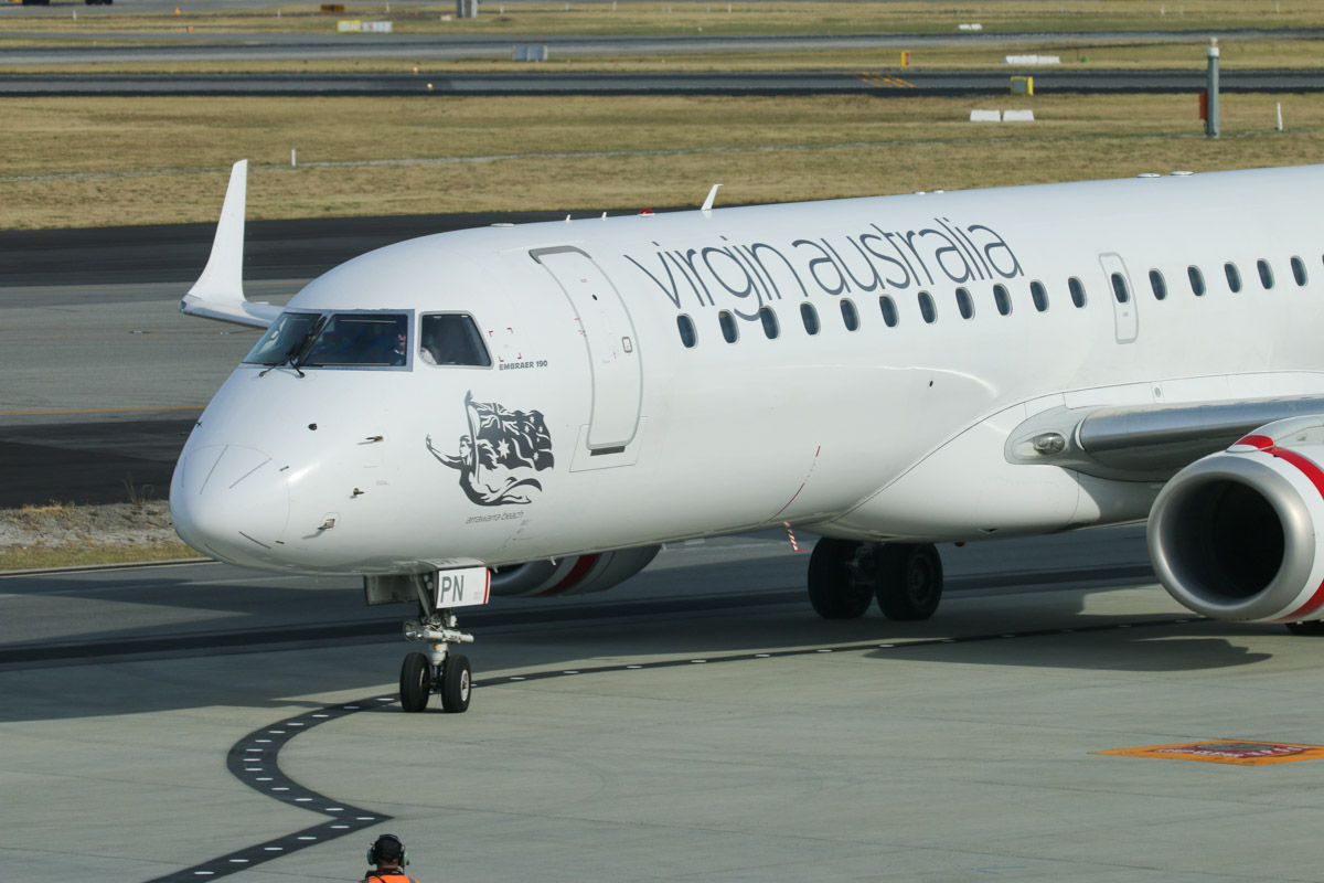 VH-ZPN Embraer 190AR (ERJ-190-100IGW) (MSN 19000312) named 'Arrawarra Beach,' of Virgin Australia, at Perth Airport - Sun 22 November 2015. The first flight to use the new Terminal 1 Domestic, flight VA713 from Adelaide, parking at Bay 148A at 7:26am. Photo © David Eyre