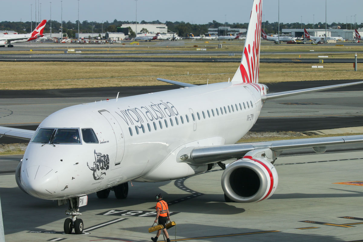 VH-ZPN Embraer 190AR (ERJ-190-100IGW) (MSN 19000312) named 'Arrawarra Beach,' of Virgin Australia, at Perth Airport - Sun 22 November 2015. The first flight to use the new Terminal 1 Domestic, flight VA713 from Adelaide, seen shutting down engines after parking at Bay 148A at 7:26am, a few minute ahead of scheduled arrival time (7:35am). Virgin Australia staff cheered and clapped as it came to a stop. Photo © David Eyre