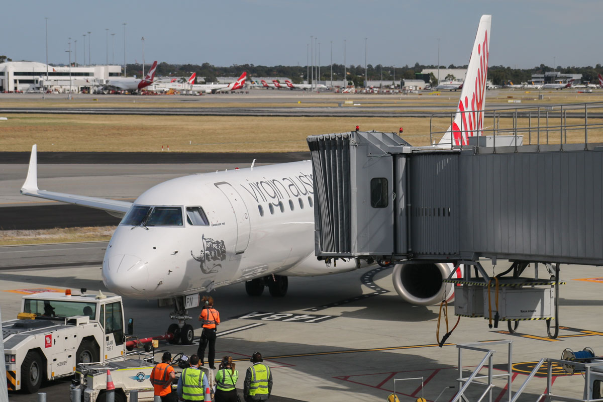 VH-ZPN Embraer 190AR (ERJ-190-100IGW) (MSN 19000312) named 'Arrawarra Beach,' of Virgin Australia, at Terminal 1 Domestic on the first day of operations, Perth Airport - Sun 22 November 2015. The first flight to depart from the new Terminal 1 Domestic, flight VA714 to Adelaide (which also operated the first arrival at the new terminal as flight VA713 from Adelaide), is seen pushing back from Bay 148A at 8:27am, a few minutes ahead of scheduled departure time (8:30am). Virgin Australia staff congratulated each other as the first arrival and departure were completed without a hitch and ahead of schedule. Photo © David Eyre