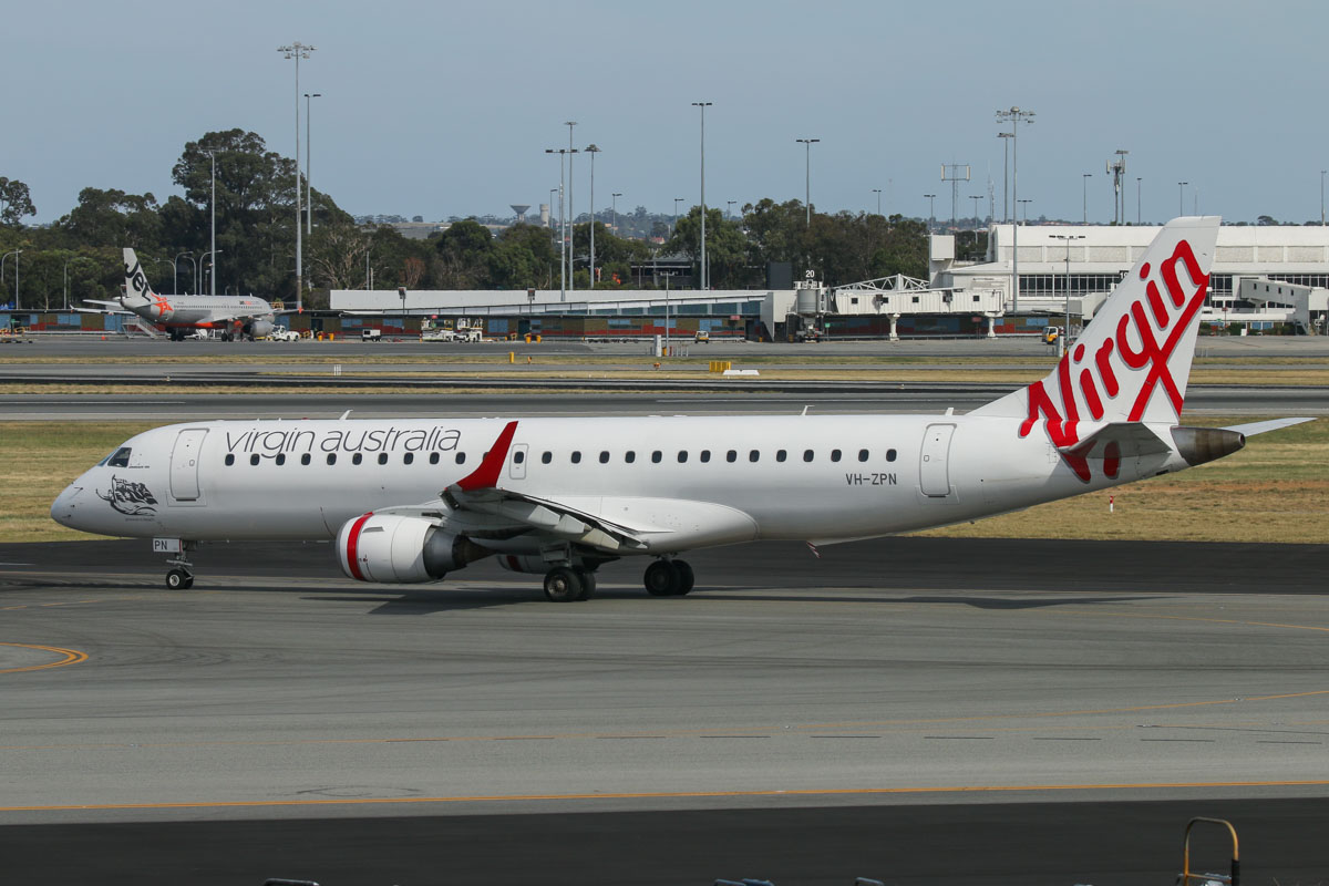 VH-ZPN Embraer 190AR (ERJ-190-100IGW) (MSN 19000312) named 'Arrawarra Beach,' of Virgin Australia, at Terminal 1 Domestic on the first day of operations, Perth Airport - Sun 22 November 2015. The first flight to depart from the new Terminal 1 Domestic, flight VA714 to Adelaide (which also operated the first arrival at the new terminal as flight VA713 from Adelaide), is seen taxying out to runway 06 at 8:32am. Photo © David Eyre