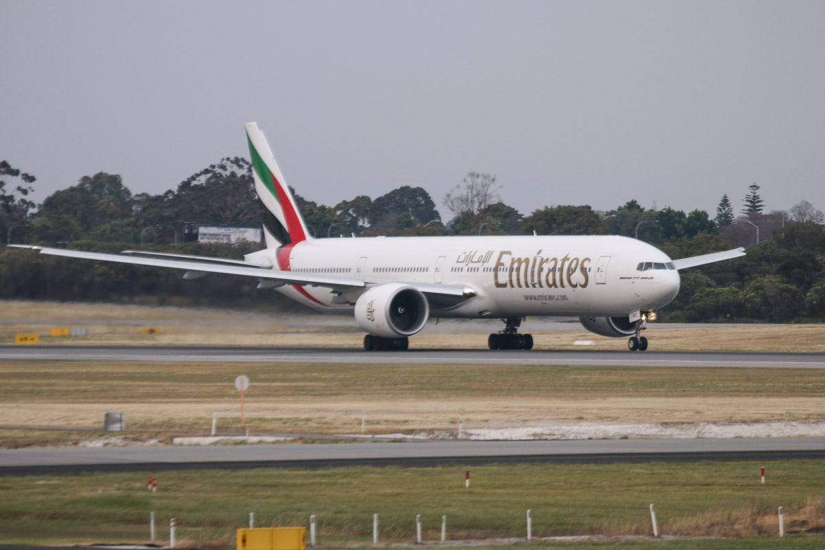 A6-EPC Boeing 777-31HER (MSN 42322/1335) of Emirates, seen from Terminal 1 Domestic, Perth Airport - Sun 22 November 2015. Taking off from runway 03 at 6:09am as flight EK425 to Dubai. Photo © David Eyre