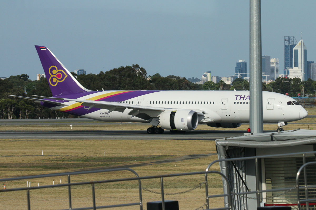 Watch out for the light poles and aerobridges! HS-TQD Boeing 787-8 Dreamliner (MSN 35320/244), named 'Wapi Pathum', of Thai Airways International, seen from left of Gate 47A, Terminal 1 Domestic, Perth Airport - Sun 22 November 2015. Landing on runway 03 at 7:35am as TG483 from Bangkok. Photo © David Eyre