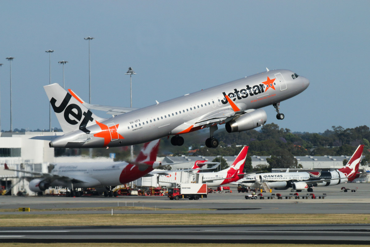 VH-VFX Airbus A320-232 (sharklets) (MSN 5871) of Jetstar, seen from right of Gate 47B/Bay 147, Terminal 1 Domestic, Perth Airport - Sun 22 November 2015. Taking off from runway 03 as JQ110 to Denpasar (Bali) at 7:34am. Qantas Domestic Terminal 4 apron in the background. Photo © David Eyre