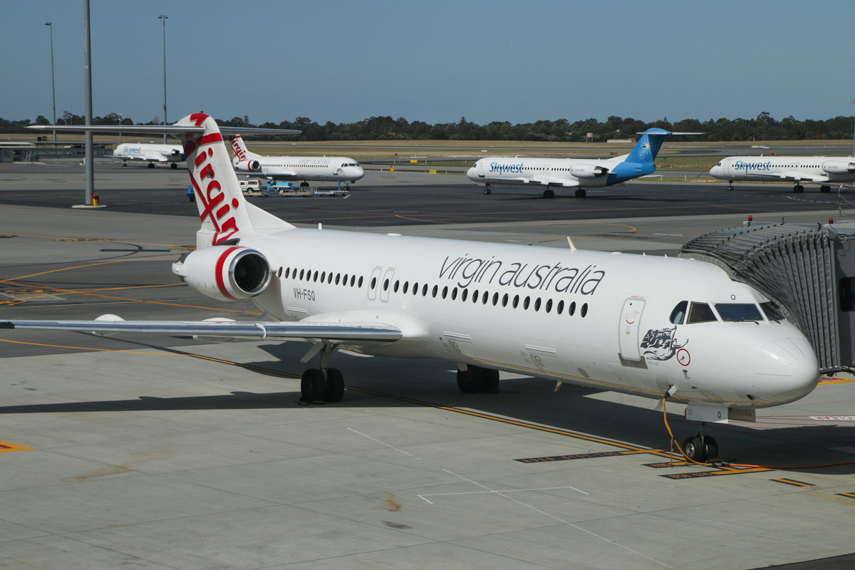 VH-FSQ Fokker 100 (MSN 11450), named 'Bill's Bay', of Virgin Australia Regional Airlines, at Gate 44/Bay 144, Terminal 1 Domestic on the first day of operations, Perth Airport - Sun 22 November 2015. This was the first Fokker 100 to depart from the new terminal, departing as flight VA1483 to Broome, pushing back from Bay 144 at 10:42am. Photo © David Eyre
