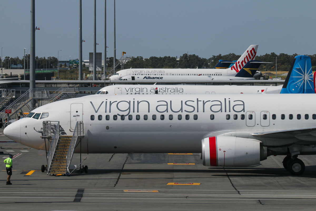 "VH-YFQ Boeing 737-8FE (MSN 41010/4494) of Virgin Australia, named ""Whiting Beach"", parked at Bay 201, viewed from Gate 44/Bay 144, Terminal 1 Domestic on the first day of operations, Perth Airport - Sun 22 November 2015. Photo © David Eyre"