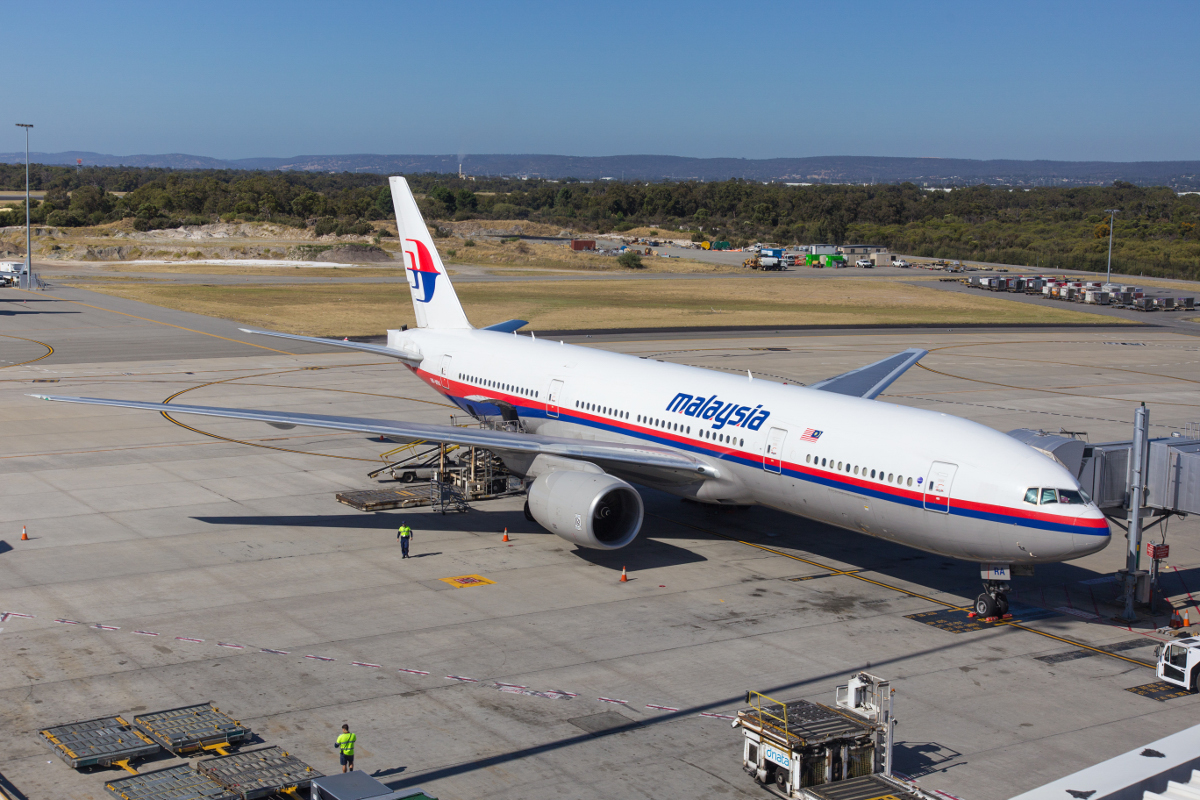 9M-MRA Boeing 777-2H6ER (MSN 28408/64) of Malaysia Airlines, at Perth Airport - Tue 8 December 2015. Replacing the usual A330-300s that operate this service. The Boeing 777-200ERs were formerly used on all Perth services. Preparing to depart as flight MH124 to Kuala Lumpur, seen at Bay 54 at Terminal 1 International at 3:53pm. Photo © Marcus Graff