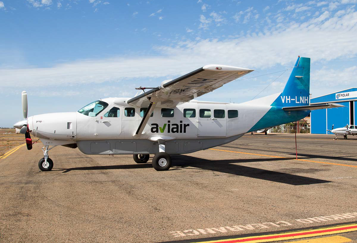 VH-LNH Cessna 208B Grand Caravan (MSN 208B0590) owned by Aviair Pty Ltd, at Port Hedland Airport - Wed 9 December 2015. Previously known as Slingair Heliwork, Aviair was established in 1984 and operates scenic air tours of the Kimberley region of Western Australia, with bases at Kununurra, Broome and Port Hedland. Photo © Jim Woodrow