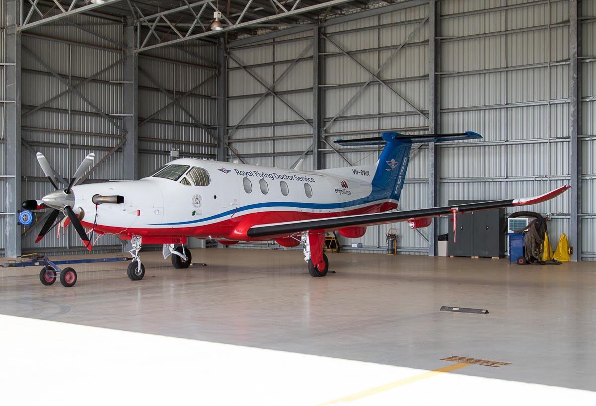 VH-OWX Pilatus PC-12/47E (MSN 1439) of the Royal Flying Doctor Service (Western Operations), at Port Hedland Airport - Wed 9 December 2015. Built in 2013, ex HB-FQM. Delivered to RFDS at Jandakot in March 2014. Seen here in their hangar at Port Hedland. Photo © Jim Woodrow