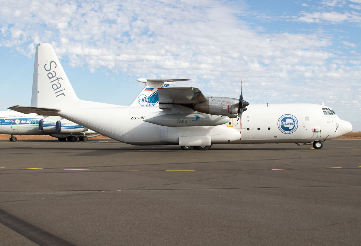 ZS-JIV Lockheed L-100-30 (L-382G) Hercules (MSN 382-4673) of Safair at Port Hedland Airport - Wed 9 December 2015. Built in 1976, ex ZS-JIV, D2-THE, ZS-JIV, EI-JIV. This aircraft is returning home to South Africa after a deployment to the Antarctic on contract to Italia Antardide, the Italian national Antarctic research organisation. It arrived in Broome from Subang (Malaysia) on 25 October 2015 (see Jonathan Williams photo of it landing, under our October 2015 photos) departing on 26 Oct 2015 to Adelaide as SAFAIR 511 and the following day to Christchurch, New Zealand, using the same flight number. It returned from Christchurch via Adelaide today, and is seen here an hour after arrival in Port Hedland. It departed the next day to Subang as SAFAIR 511. Photo © Jim Woodrow