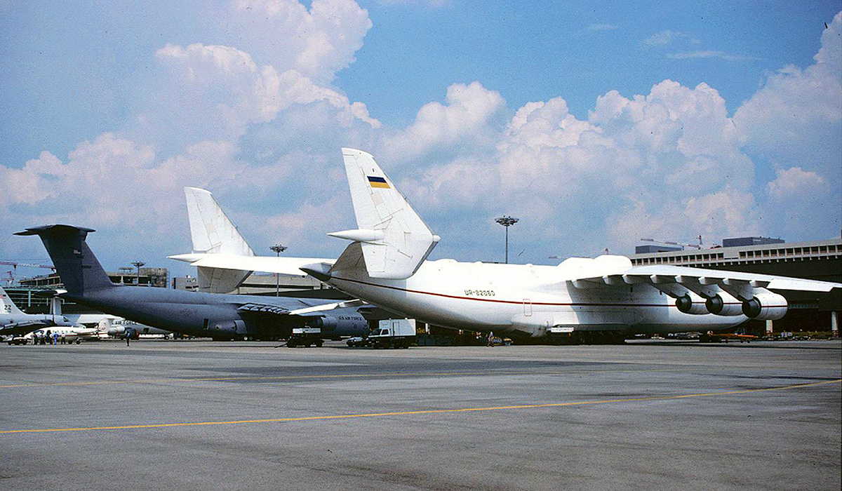 UR-82060 Antonov An-225 Mriya (MSN 19530503763) of Antonov Airlines (Antonov Design Bureau) at Asian Aerospace 1994, Singapore - 23 February 1994. Parked next to a US Air Force Lockheed C-5A Galaxy, which was once the world's largest operational aircraft. Photo © Keith Anderson