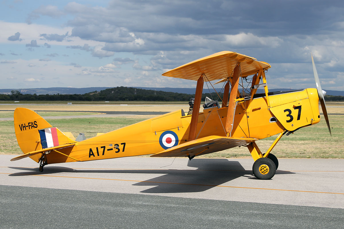 "VH-FAS / A17-37 De Havilland DH.82A Tiger Moth (MSN DHA34) of Griffin Aviation Pty Ltd (operated by Royal Aero Club of Western Australia Inc) piloted by Mick Harcourt taxying out to take part in the ""Beautiful Bi-planes"" formation in the Australia Day City of Perth Air Show."