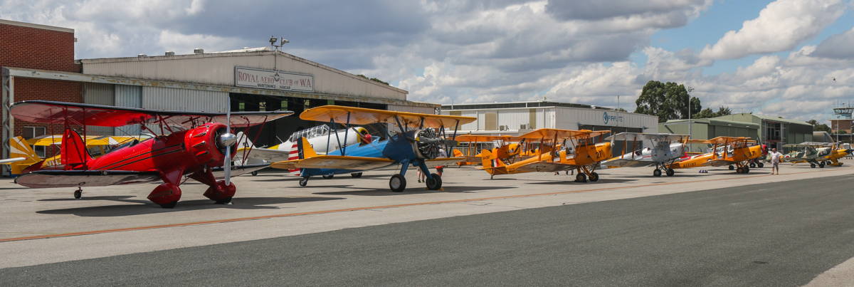 Vintage aircraft line-up at Jandakot Airport - Tue 26 January 2016 - Australia Day Air Show. Left to right in the front row are VH-YDF / 4269 / 591 Boeing B75N1 (N2S-3) Stearman; VH-YRB WACO Aircraft YMF-F5C; VH-URC Boeing A75N1 Stearman (PT-17 Kaydet);, and three De Havilland DH.82A Tiger Moths: VH-CKF/A17-421; VH-FAS / A17-37; and VH-NOV (MSN DHA1088); VH-KIL/14 CASA 1-131E Jungmann; and VH-VLF Steen Skybolt. Photo © David Eyre