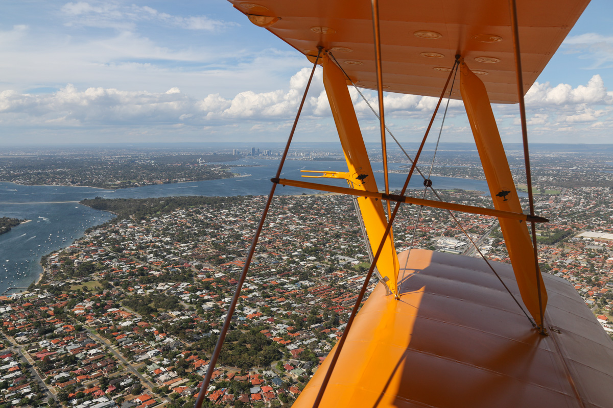 View northeast along Swan River to Perth from VH-BTP / A17-744 De Havilland DH-82A Tiger Moth (MSN DHA1075/T315) flown by Clark Rees, over East Fremantle - Tue 26 January 2016 - Australia Day Air Show. Black Wall Reach, Point Walter and Bicton visible. Photo © David Eyre