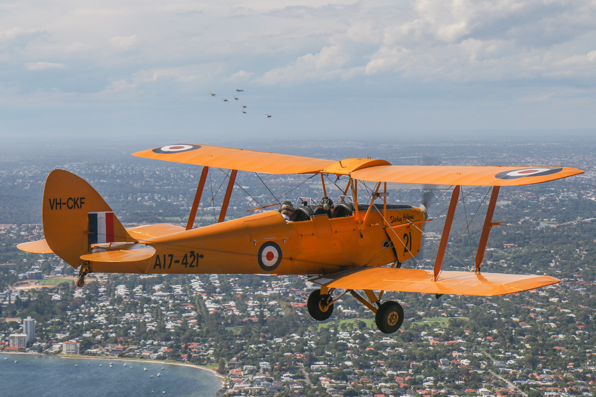 VH-CKF/A17-421 De Havilland DH-82A Tiger Moth (MSN DHA596/T200) owned by the Royal Aero Club of Western Australia, flown by Trevor Jones, over the Swan River at Bicton, Tue 26 January 2016 - Australia Day Air Show. View facing north towards Claremont and Dalkeith, as the 'Oldtimers' formation approaches from the north, having completed their first flypasts over the city. Photo taken from VH-BTP / A17-744 De Havilland DH-82A Tiger Moth (MSN DHA1075/T315) owned by Clark Rees Photo © David Eyre