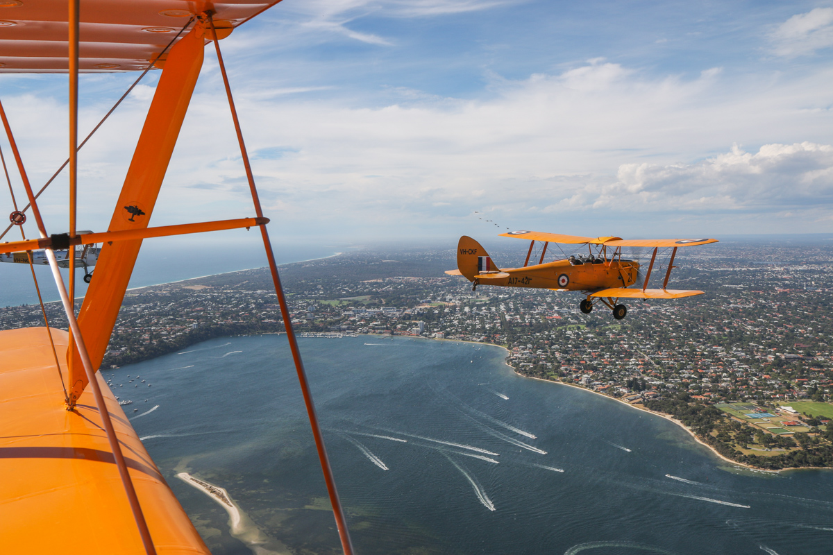 VH-CKF/A17-421 De Havilland DH-82A Tiger Moth (MSN DHA596/T200) owned by the Royal Aero Club of Western Australia, flown by Trevor Jones, over the Swan River at Bicton, Tue 26 January 2016 - Australia Day Air Show. View facing north towards Claremont and Dalkeith, as the 'Oldtimers' formation approaches from the north, having completed their first flypasts over the city. Tiger Moth VH-NOV (MSN DHA1088) flown by Barry Markham is off our left wing. Photo taken from VH-BTP / A17-744 De Havilland DH-82A Tiger Moth (MSN DHA1075/T315) owned by Clark Rees Photo © David Eyre