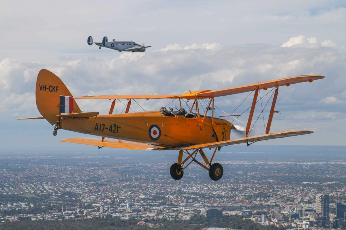 VH-CKF/A17-421 De Havilland DH-82A Tiger Moth (MSN DHA596/T200) owned by the Royal Aero Club of Western Australia, flown by Trevor Jones, and VH-FID Beech D.18S (MSN A-458), flown by Stuart Adamson, over the Swan River at Crawley, Tue 26 January 2016 - Australia Day Air Show. View facing northeast towards West Perth. AAWA Vice President Keith Anderson was aboard VH-FID in the background. Photo taken from VH-BTP / A17-744 De Havilland DH-82A Tiger Moth (MSN DHA1075/T315) owned by Clark Rees Photo © David Eyre