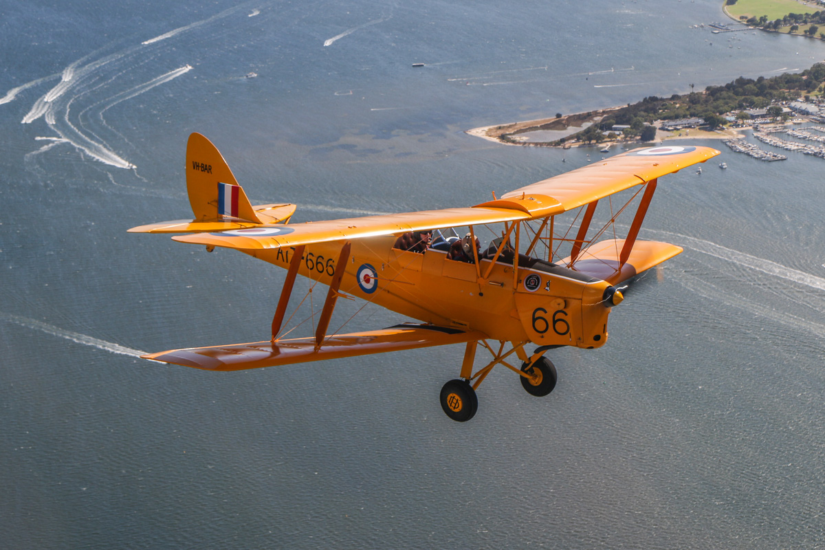 VH-BAR/A17-666 De Havilland DH-82A Tiger Moth (MSN DHA816/T342) flown by Kevin Bailey, over the Swan River near Matilda Bay, Crawley, Tue 26 January 2016 - Australia Day Air Show. Pelican Point at Crawley is visible at upper right. This was a former World War Two seaplane base, used by Catalina flying boats of the US Navy. Photo taken from VH-BTP / A17-744 De Havilland DH-82A Tiger Moth (MSN DHA1075/T315) owned by Clark Rees. Photo © David Eyre