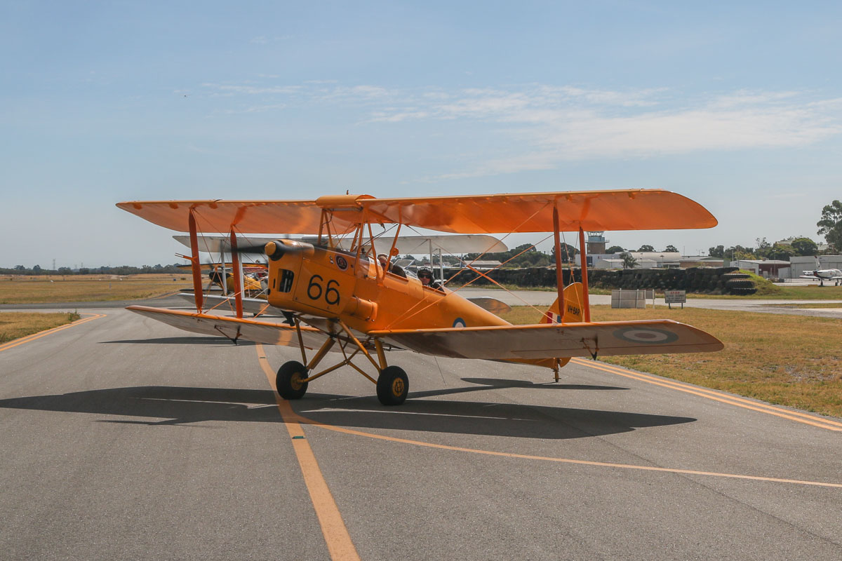 VH-BAR/A17-666 De Havilland DH-82A Tiger Moth (MSN DHA816/T342) owned and flown by Kevin Bailey, at Jandakot Airport - Tue 26 January 2016 - Australia Day Air Show. Holding on taxiway B near runway 24R, to do engine run-up checks before departure. Visible behind are Tiger Moth VH-AMW/A17-208 flown by Chris Shine; VH-BQO Christen Eagle II flown by Adam Gibbs; VH-VLF Steen Skybolt flown by Roberto Franco; and VH-ZUZ Culp Special flown by Peter Cash. Photo taken from VH-BTP / A17-744 De Havilland DH-82A Tiger Moth (MSN DHA1075/T315) owned by Clark Rees, Photo © David Eyre
