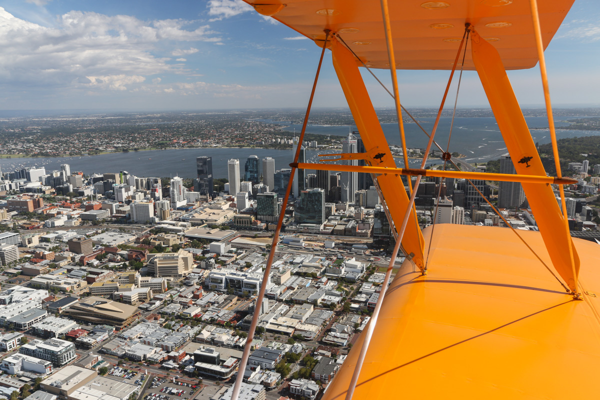 The city of Perth, seen from VH-BTP / A17-744 De Havilland DH-82A Tiger Moth (MSN DHA1075/T315) flown by Clark Rees, over Northbridge - Tue 26 January 2016 - Australia Day Air Show. Flying southeast, parallel to the northern foreshore, before we commenced our first formation flypast. Photo © David Eyre