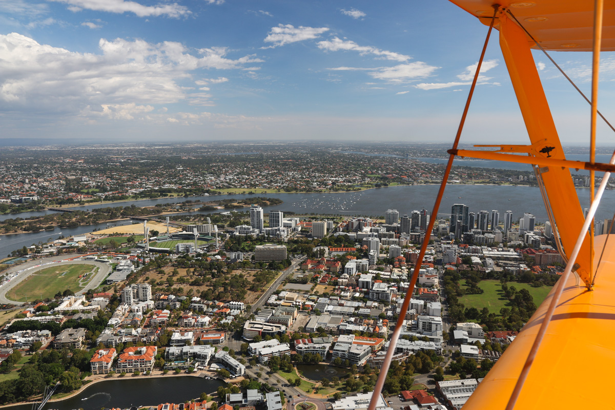 East Perth, Heirisson Island, and South Perth, seen from VH-BTP / A17-744 De Havilland DH-82A Tiger Moth (MSN DHA1075/T315) flown by Clark Rees, over East Perth, Tue 26 January 2016 - Australia Day Air Show. At bottom left is Claisebrook Cove, centre left is Gloucester Park trotting racetrack and to its right is the WACA cricket ground. Photo © David Eyre