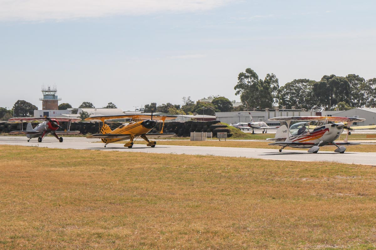 Left to right: VH-ZUZ Culp Special (MSN CS-1947), flown by Peter Cash; VH-VLF Steen Skybolt (MSN DG001), flown by Roberto Franco; and VH-BQO Christen Eagle II (MSN V81), flown by Adam Gibbs, at Jandakot Airport - Tue 26 January 2016 - Australia Day Air Show. Holding on taxiway B near runway 24R, awaiting their turn to take off as part of our formation. Photo taken from VH-BTP / A17-744 De Havilland DH-82A Tiger Moth (MSN DHA1075/T315) owned by Clark Rees. Photo © David Eyre