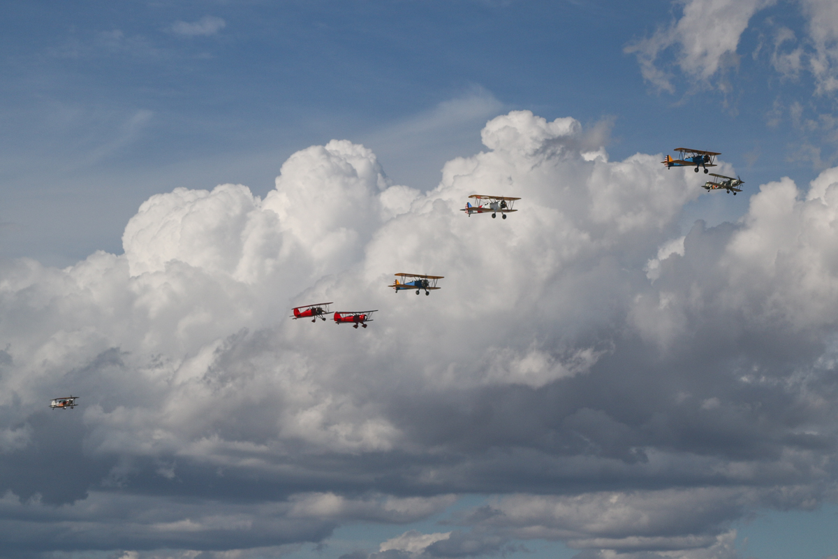 """Oldtimers formation, over East Perth - Tue 26 January 2016 - Australia Day Air Show. About to perform their second pair of flypasts over the Swan River. Aircraft in the formation are (L-R): VH-BQO Christen Eagle II (MSN V81), flown by Adam Gibbs; VH-WQW Great Lakes 2T-1A-2 Sport Trainer, flown by Franc Smit; VH-YRB WACO Aircraft YMF-F5C, flown by Archie Dudgeon; Boeing Stearmans VH-URC in US Army Air Corps markings, flown by Rod Edwards; VH-YND / """"42–755362 / 362"""" in US Navy markings, flown by Carl Ende; VH-YDF / 4269 / 591, flown by Werner Buhlmann; and VH-KIL / """"14"""" CASA 1-131E Jungmann, in Japanese markings, flown by Bert Filippi. Photo taken from VH-BTP / A17-744 De Havilland DH-82A Tiger Moth (MSN DHA1075/T315) owned by Clark Rees. Photo © David Eyre"""
