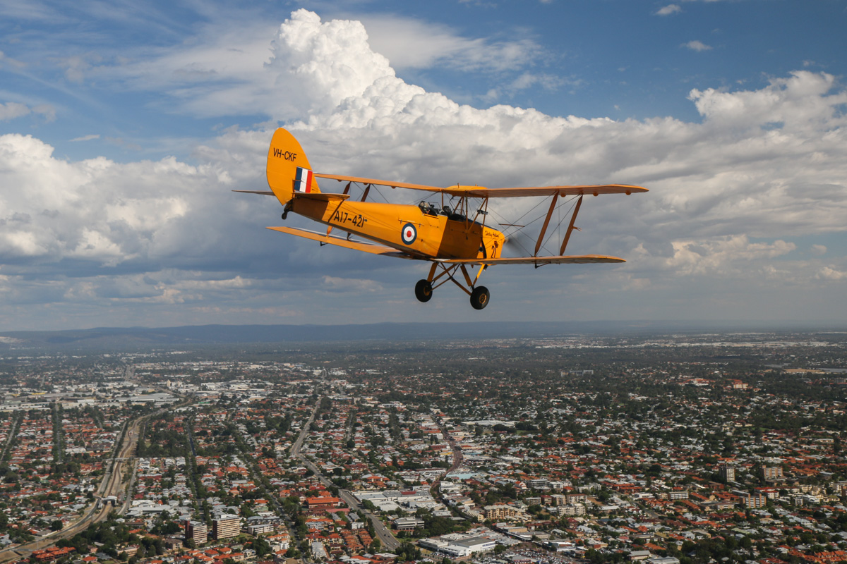 VH-CKF/A17-421 De Havilland DH-82A Tiger Moth (MSN DHA596/T200), flown by Trevor Jones, over the Swan River near Victoria Park, Tue 26 January 2016 - Australia Day Air Show. Descending to the right, to commence the flypast. Photo taken from VH-BTP / A17-744 De Havilland DH-82A Tiger Moth (MSN DHA1075/T315) flown by Clark Rees. Photo © David Eyre