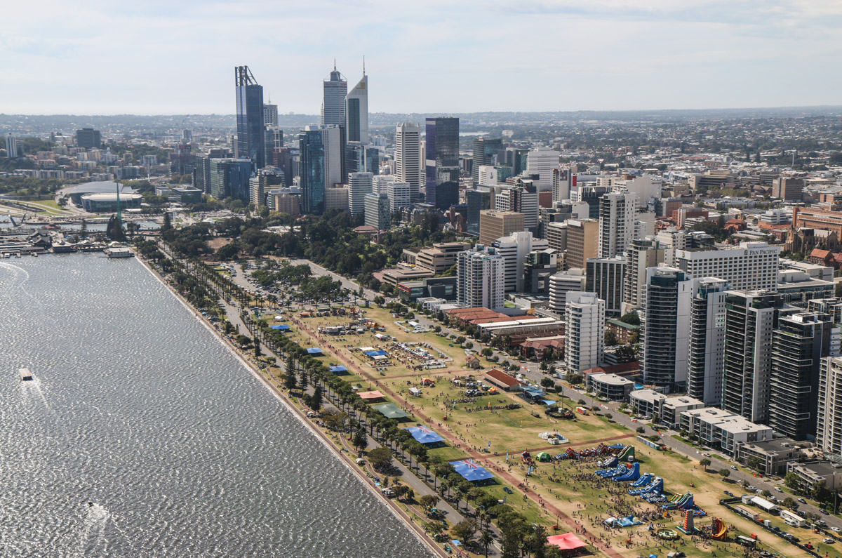 Perth city and the former unofficial airport at Langley Park, seen from VH-BTP / A17-744 De Havilland DH-82A Tiger Moth (MSN DHA1075/T315) flown by Clark Rees, over the Swan River near East Perth, Tue 26 January 2016 - Australia Day Air Show. In 1919 Norman Brearley moved his two Avro 504J biplanes and their hangar to the northwest corner of what later became Langley Park, from his initial base base next to Belmont Park Racecourse. This was public land and he had no official permission. In 1921, Brearley won a tender for the first regular air service in Australia (before Qantas), and based his airline West Australian Airways at Langley Park. It remained in use as an unofficial airport from late 1919 to January 1924, when Maylands Aerodrome opened. Thereafter, it was used occasionally for emergencies and special events, such as fly-ins and the Red Bull Air Race. Photo © David Eyre