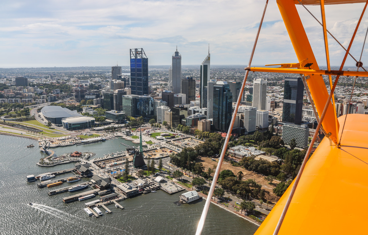 Perth city, seen from VH-BTP / A17-744 De Havilland DH-82A Tiger Moth (MSN DHA1075/T315) flown by Clark Rees, over the Swan River, Tue 26 January 2016 - Australia Day Air Show. The newly completed inlet at Elizabeth Quay was officially opened three days after this photo, on 29 January 2016. Photo © David Eyre