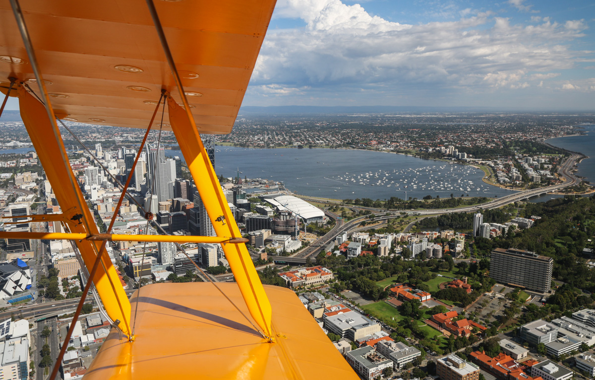Perth city, West Perth, Swan River and South Perth, seen from VH-BTP / A17-744 De Havilland DH-82A Tiger Moth (MSN DHA1075/T315) flown by Clark Rees, over West Perth, Tue 26 January 2016 - Australia Day Air Show. Photo © David Eyre