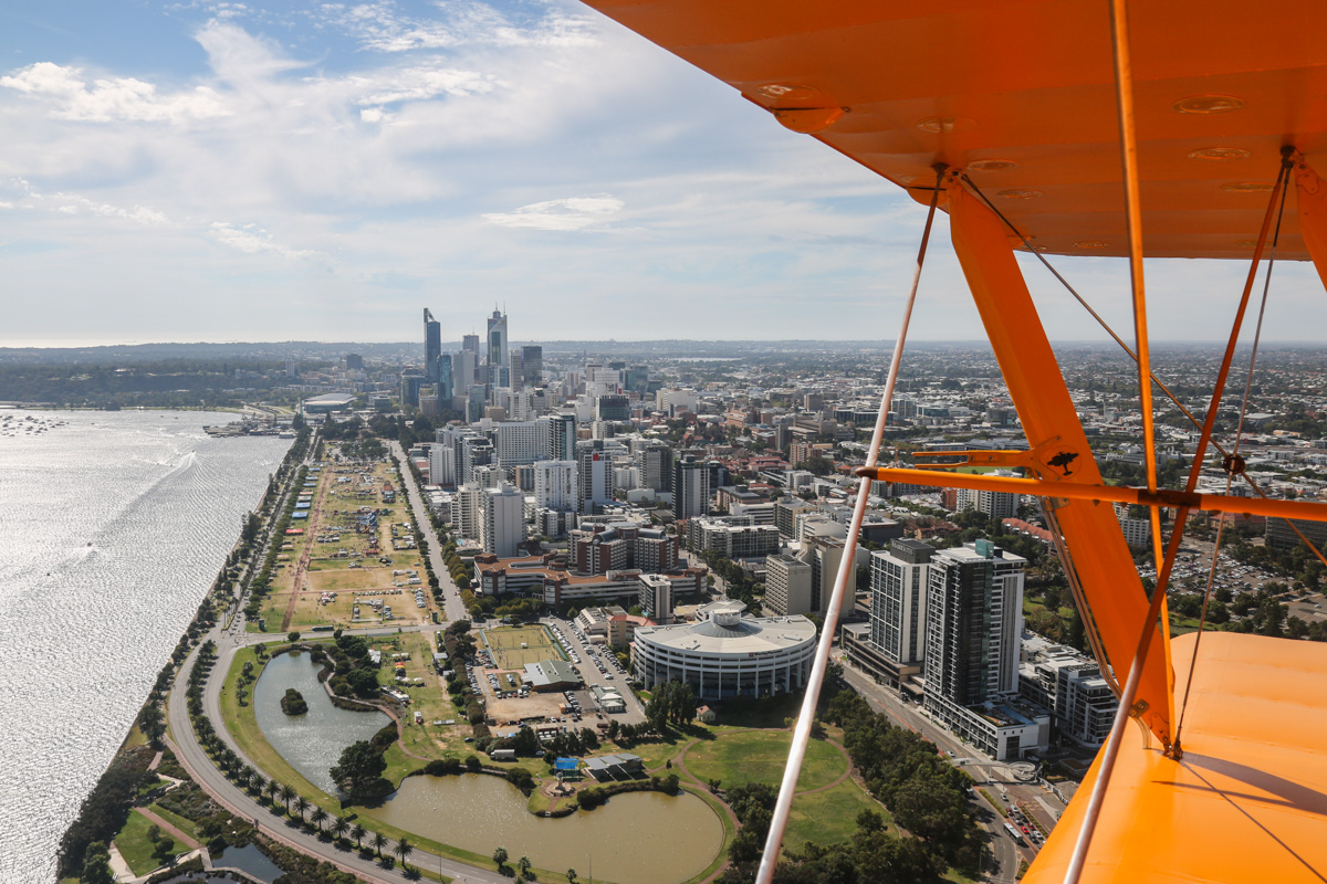 Perth city, East Perth, and Langley Park, seen from VH-BTP / A17-744 De Havilland DH-82A Tiger Moth (MSN DHA1075/T315) flown by Clark Rees, over East Perth, Tue 26 January 2016 - Australia Day Air Show. In 1919, without official permission, Norman Brearley moved his Avro 504J biplanes and hangar from his initial base base next to Belmont Park Racecourse to the northwest corner of what later became Langley Park. In 1921, Brearley won a tender for the first regular air service in Australia (before Qantas), and based his airline West Australian Airways at Langley Park. It remained in use as an unofficial airport until January 1924, when Maylands Aerodrome opened. Thereafter, it was used occasionally for emergencies and special events, such as fly-ins and the Red Bull Air Race. Photo © David Eyre
