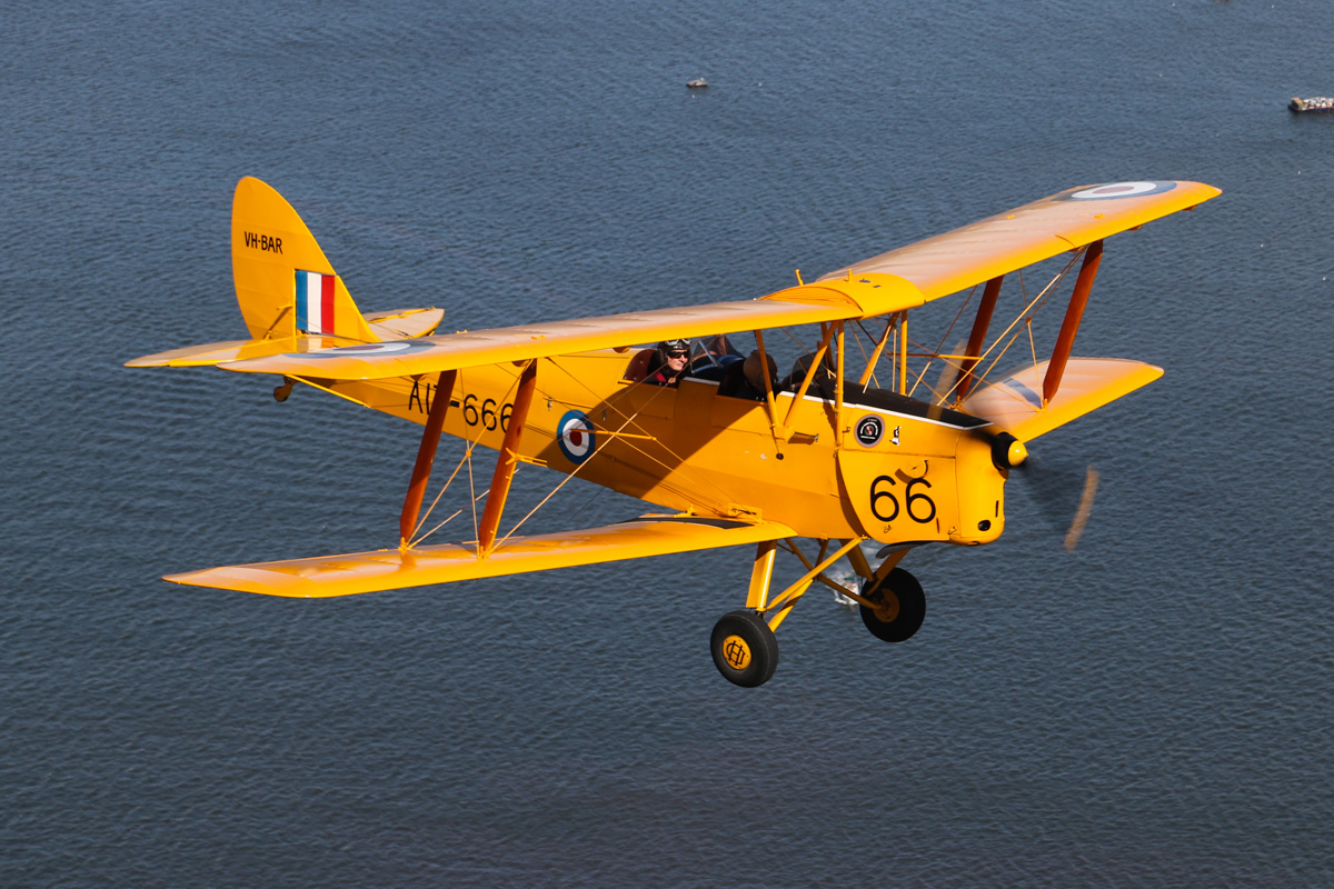 VH-BAR/A17-666 De Havilland DH-82A Tiger Moth (MSN DHA816/T342) flown by Kevin Bailey, over the Swan River near South Perth - Tue 26 January 2016 - Australia Day Air Show. Flying towards the Narrows Bridge. Photo taken from VH-BTP / A17-744 De Havilland DH-82A Tiger Moth (MSN DHA1075/T315) owned by Clark Rees. Photo © David Eyre