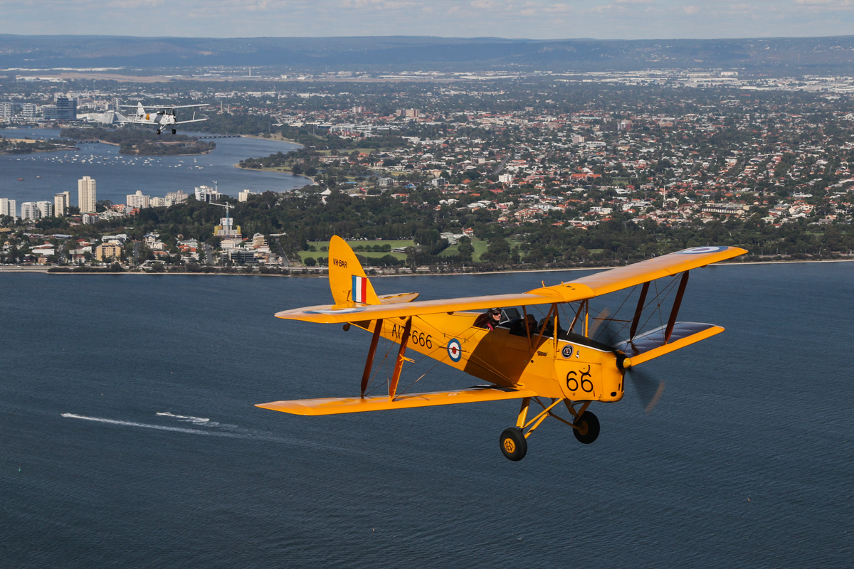 De Havilland DH-82A Tiger Moths VH-BAR/A17-666 (MSN DHA816/T342) flown by Kevin Bailey; and VH-AMW/A17-208 (MSN DHA209) flown by Chris Shine, over the Swan River near South Perth - Tue 26 January 2016 - Australia Day Air Show. Flying southwest, back to Jandakot. Photo taken from VH-BTP / A17-744 De Havilland DH-82A Tiger Moth (MSN DHA1075/T315) owned by Clark Rees. Photo © David Eyre