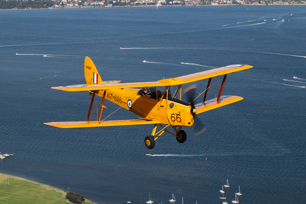 VH-BAR/A17-666 De Havilland DH-82A Tiger Moth (MSN DHA816/T342) flown by Kevin Bailey, over Charles Court Reserve, Nedlands - Tue 26 January 2016 - Australia Day Air Show. Flying southwest, back to Jandakot. Photo taken from VH-BTP / A17-744 De Havilland DH-82A Tiger Moth (MSN DHA1075/T315) owned by Clark Rees. Photo © David Eyre