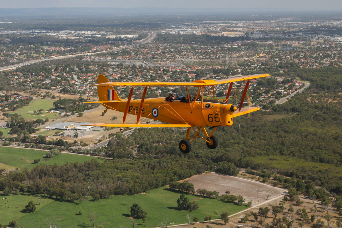 VH-BAR/A17-666 De Havilland DH-82A Tiger Moth (MSN DHA816/T342) owned and flown by Kevin Bailey, over Murdoch - Tue 26 January 2016 - Australia Day Air Show. Climbing to the northwest after departing Jandakot, south of Murdoch University. Photo taken from VH-BTP / A17-744 De Havilland DH-82A Tiger Moth (MSN DHA1075/T315) owned by Clark Rees. Photo © David Eyre