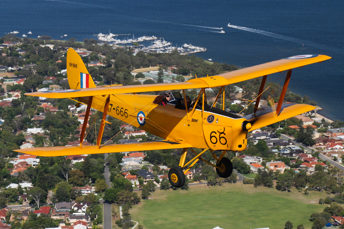 VH-BAR/A17-666 De Havilland DH-82A Tiger Moth (MSN DHA816/T342) flown by Kevin Bailey, over David Cruickshank Reserve, Dalkeith - Tue 26 January 2016 - Australia Day Air Show. Flying southwest, back to Jandakot. Swan River in the background. Photo taken from VH-BTP / A17-744 De Havilland DH-82A Tiger Moth (MSN DHA1075/T315) owned by Clark Rees. Photo © David Eyre