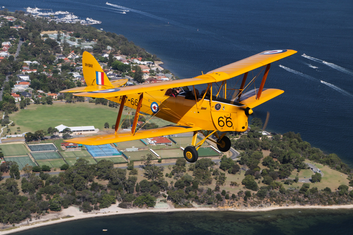 VH-BAR/A17-666 De Havilland DH-82A Tiger Moth (MSN DHA816/T342) flown by Kevin Bailey, over the Swan River near Point Resolution Reserve, Dalkeith - Tue 26 January 2016 - Australia Day Air Show. Flying southwest, back to Jandakot. Photo taken from VH-BTP / A17-744 De Havilland DH-82A Tiger Moth (MSN DHA1075/T315) owned by Clark Rees. Photo © David Eyre