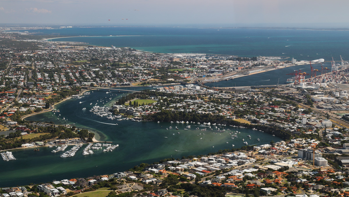 North Fremantle, East Fremantle and Fremantle city, seen from VH-BTP / A17-744 De Havilland DH-82A Tiger Moth (MSN DHA1075/T315) flown by Clark Rees, over Mosman Park, Tue 26 January 2016 - Australia Day Air Show. Fremantle Port is visible upper right, with Garden Island above it. Photo © David Eyre