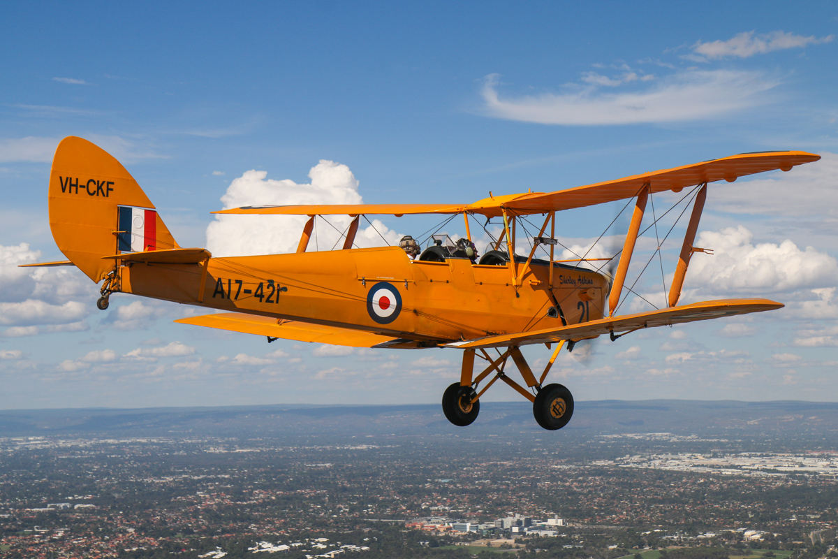 VH-CKF/A17-421 De Havilland DH-82A Tiger Moth (MSN DHA596/T200), flown by Trevor Jones, over Hamilton Hill, Tue 26 January 2016 - Australia Day Air Show. Heading back to Jandakot. Photo taken from VH-BTP / A17-744 De Havilland DH-82A Tiger Moth (MSN DHA1075/T315) flown by Clark Rees. Photo © David Eyre