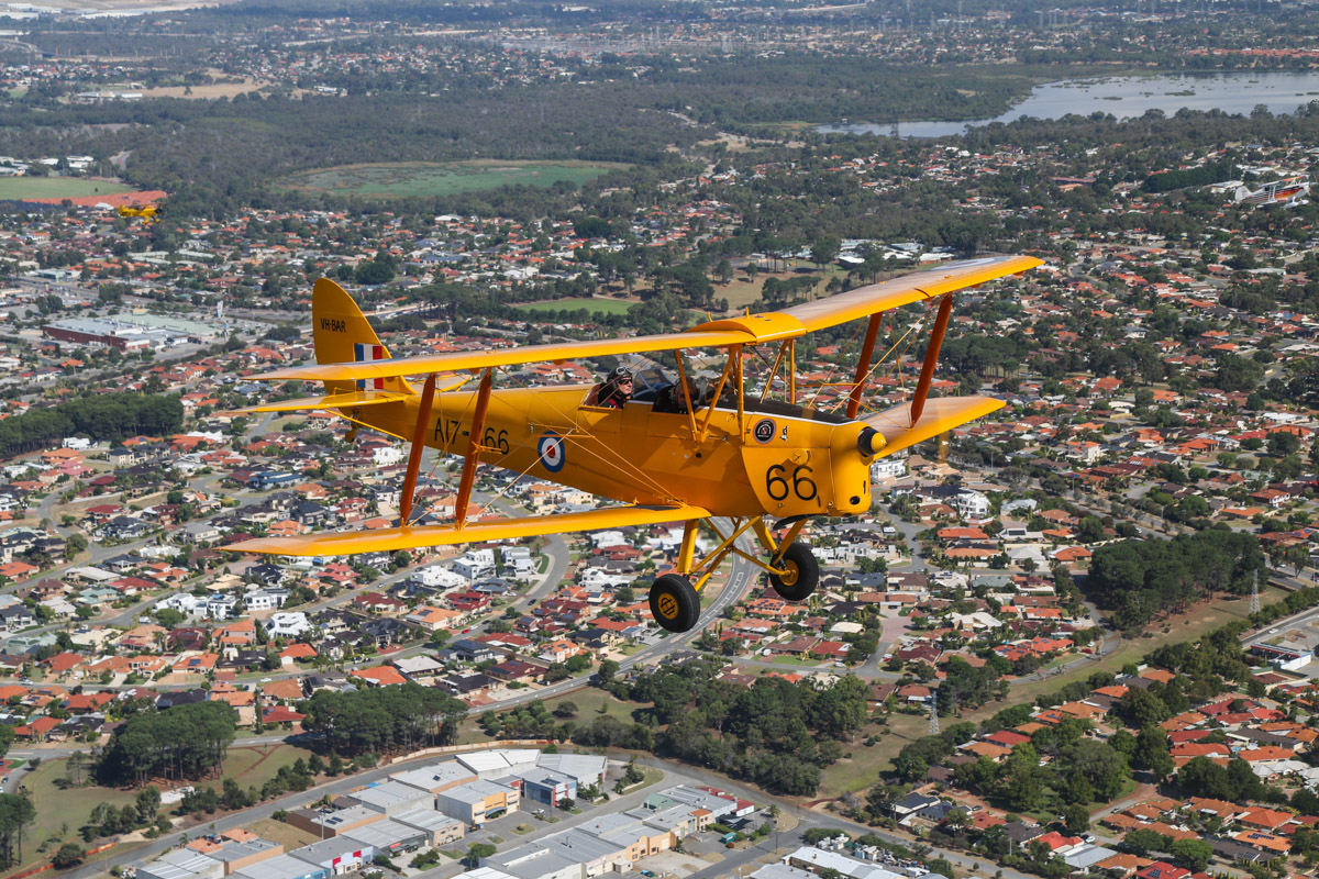 VH-BAR/A17-666 De Havilland DH-82A Tiger Moth (MSN DHA816/T342) owned and flown by Kevin Bailey, over O'Connor - Tue 26 January 2016 - Australia Day Air Show. Flying northwest after departing Jandakot. Bibra Lake is visible at the upper right of photo. Photo taken from VH-BTP / A17-744 De Havilland DH-82A Tiger Moth (MSN DHA1075/T315) owned by Clark Rees. Photo © David Eyre