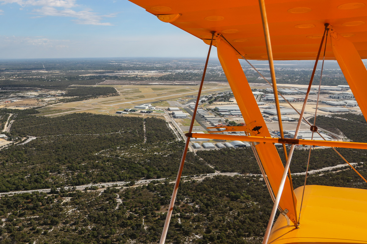 Jandakot Airport, seen from VH-BTP / A17-744 De Havilland DH-82A Tiger Moth (MSN DHA1075/T315) flown by Clark Rees, over Leeming - Tue 26 January 2016 - Australia Day Air Show. View to our right side, turning onto the base leg for landing on runway 24R. Photo © David Eyre
