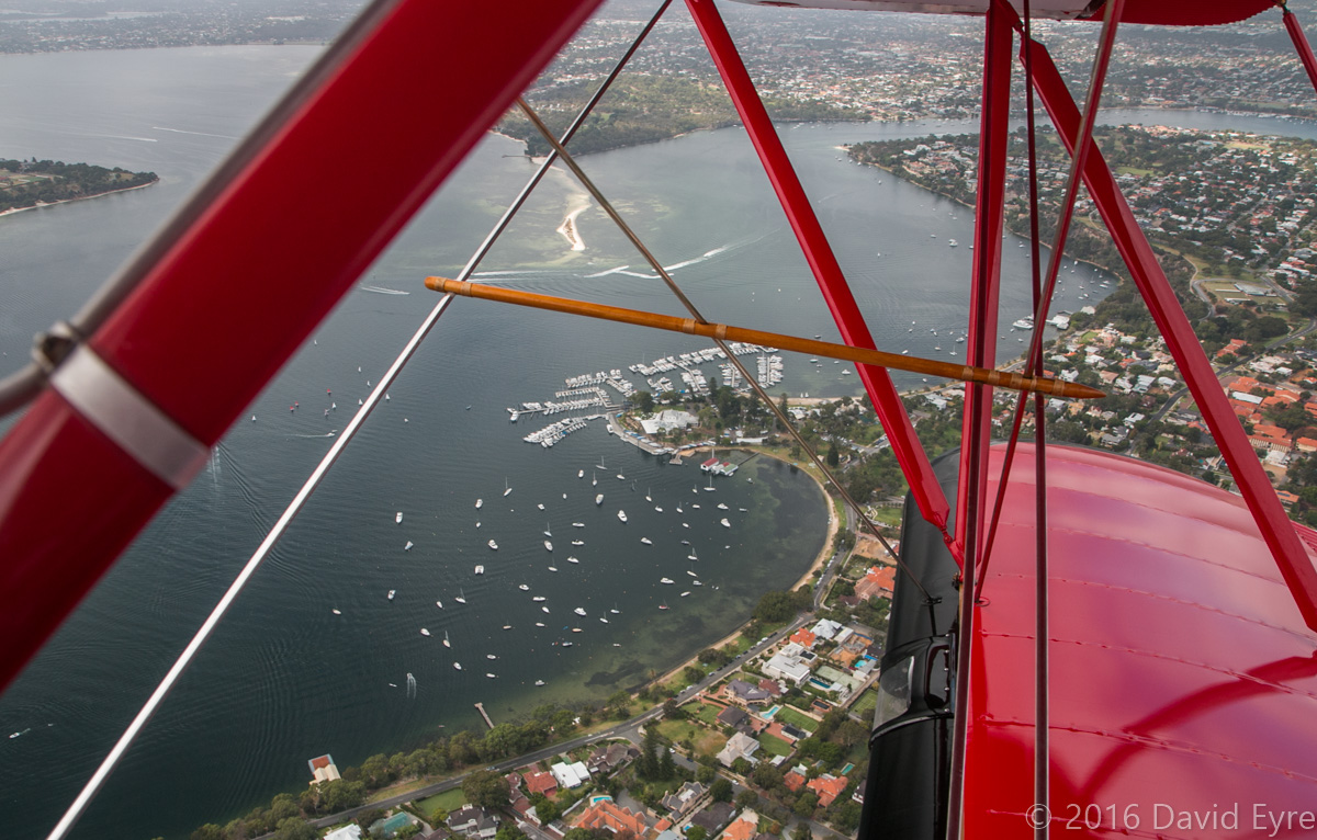 View of Royal Freshwater Bay Yacht Club at Peppermint Grove, with Mosman Park and Bicton in the distance, seen from VH-YRB WACO Aircraft YMF-F5C (MSN F5C105), owned by Archie Dudgeon, heading northeast over Claremont, Perth - Sun 28 February 2016. Photo © David Eyre