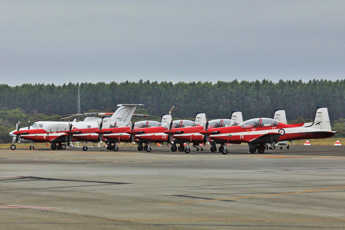 Six Pilatus PC-9/A aircraft of 2 FTS, RAAF, at Albany Airport - Thu 3 March 2016. A detachment of up to nine PC-9/As from Number 2 Flying Training School (2FTS) and one RAAF Rescue helicopter (Bell 412EP VH-EPH) deployed from RAAF Base Pearce to conduct flight training from Albany Regional Airport from 21 February to 4 March 2016. 2FTS deploys to Albany once or twice a year to conduct the formation training phase of the Advanced Pilots' Course. From front to rear are: VH-EPH Bell 412EP of CHC Helicopters under contract to the RAAF as a rescue helicopter, VH-XDB Beech 200 King Air of Star Aviation, and PC-9As A23-018, A23-..., A23-04., A23-023, A23-017, A23-028. Photo © Jonathan Williams