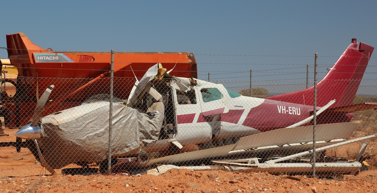 VH-ERU Cessna C210 (MSN 21058520) of Lacy Contracting Services – 13 March 2016. located in a yard at Cue, having crashed on 1st August 2015 after an engine failure.